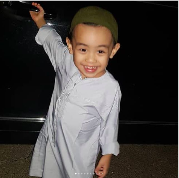 All smile as he stood in front of the car, ready to go to the Mosque!