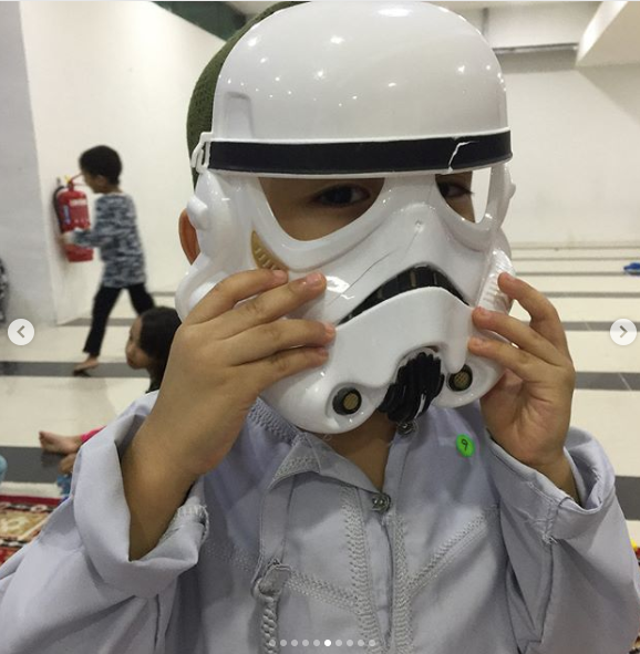 Fooling around with the Star Wars mask at the Masjid