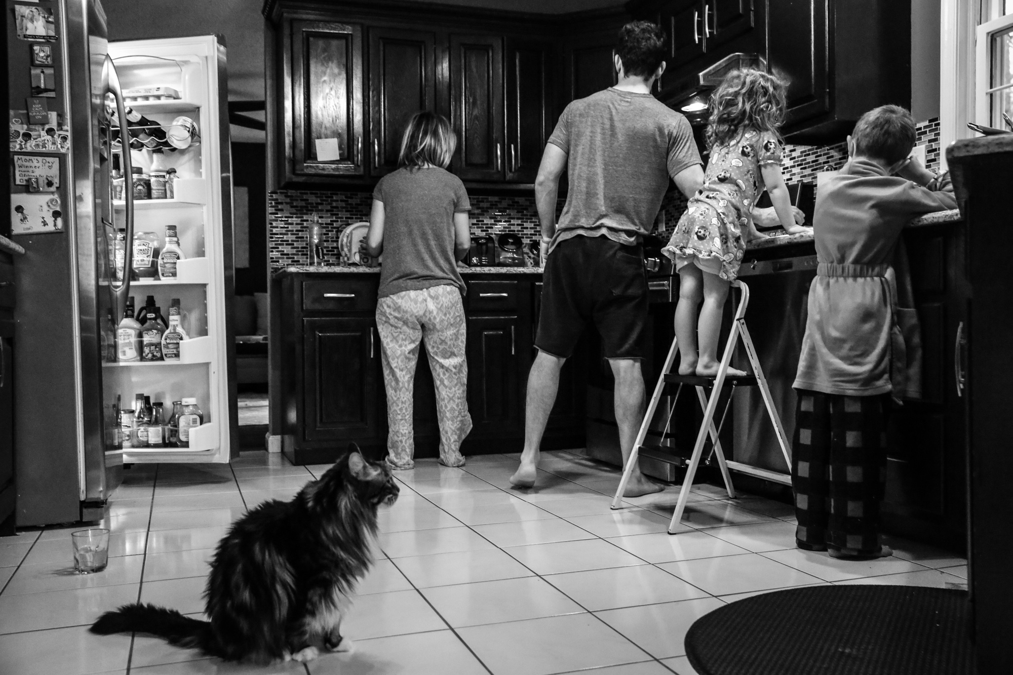 Family gets ready for breakfast with cat