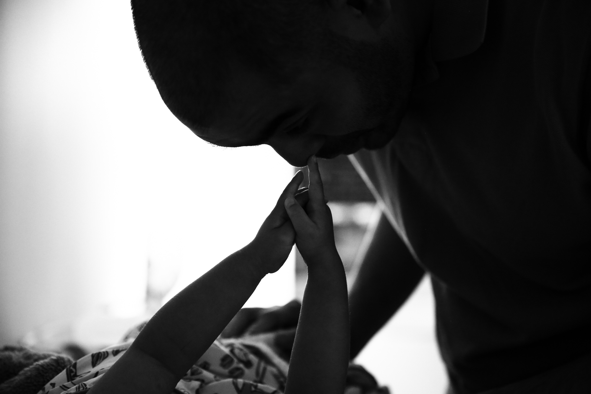 Girl's hands point and touch man's nose