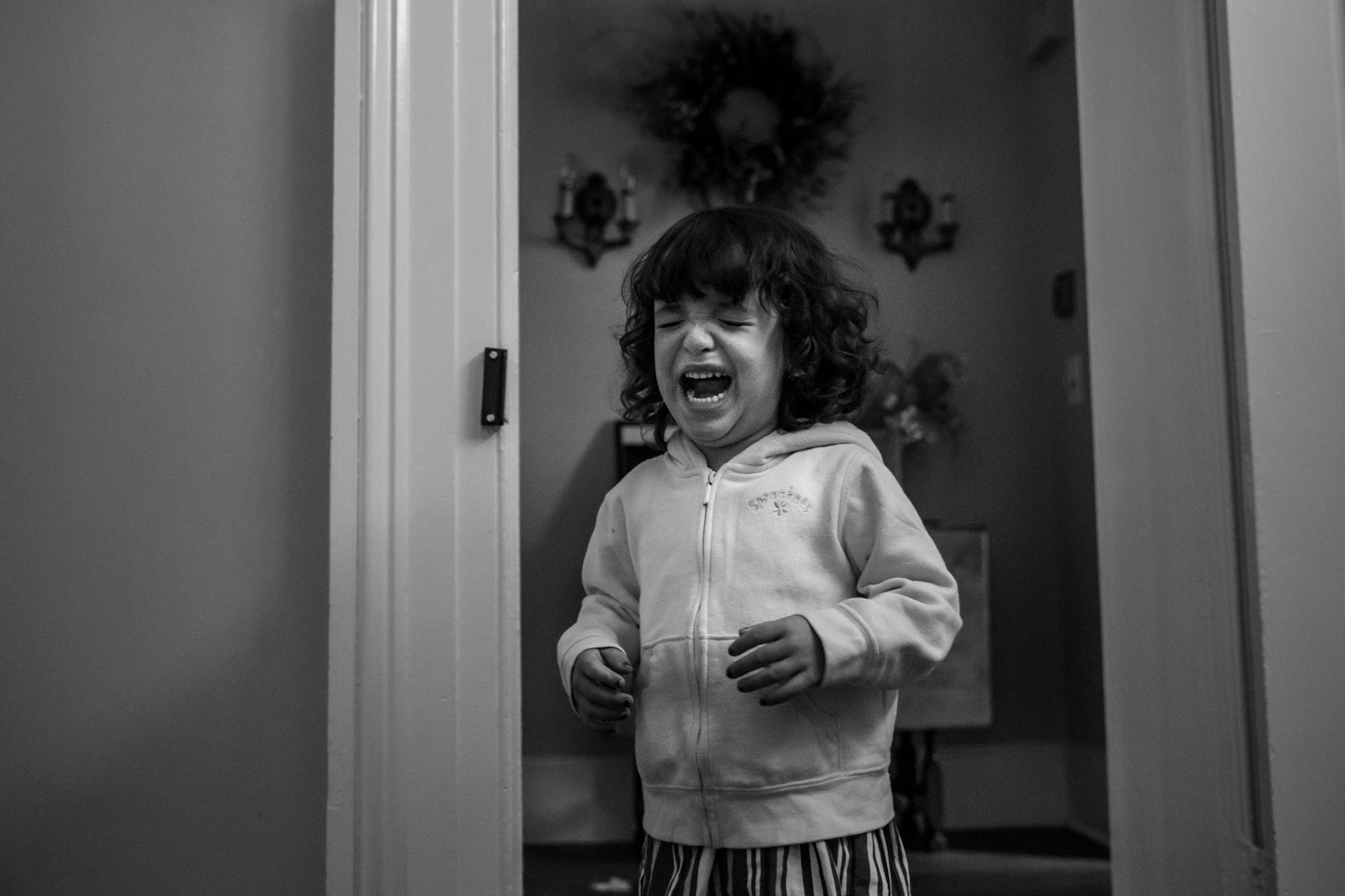 Girl cries in doorway