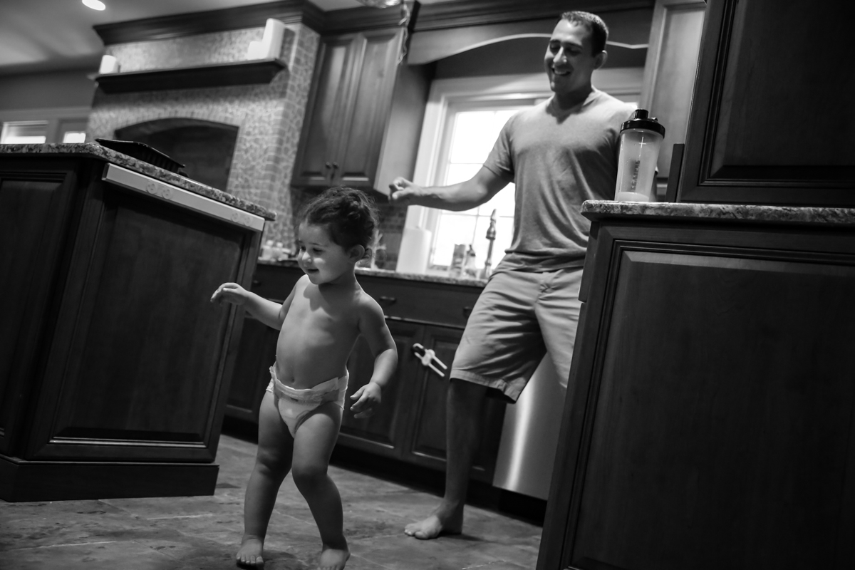Girl in diaper dances with man