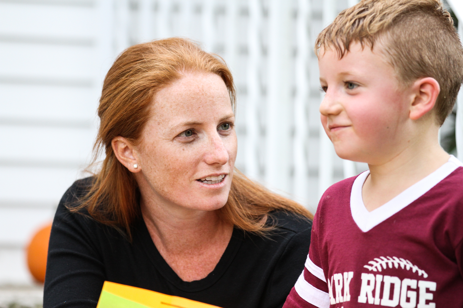 Woman asks boy questions while boy ponders