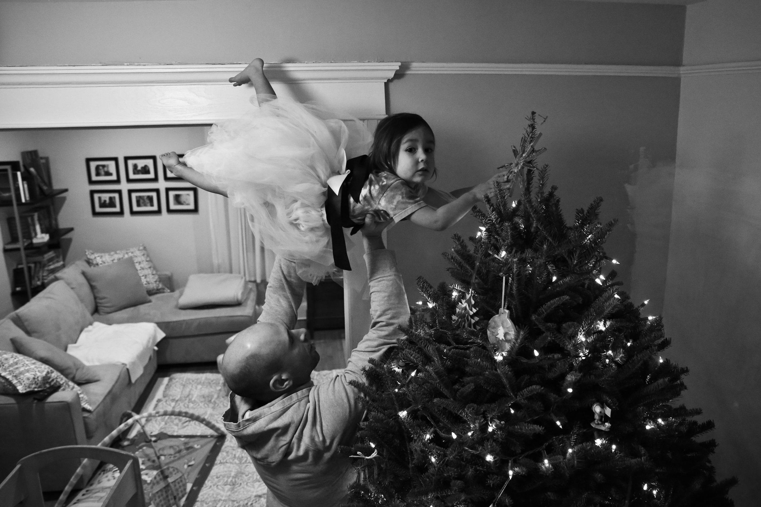 Viola topping off the tree with a star, circa 2014. I know I'll be crying the day she is too big to do this.