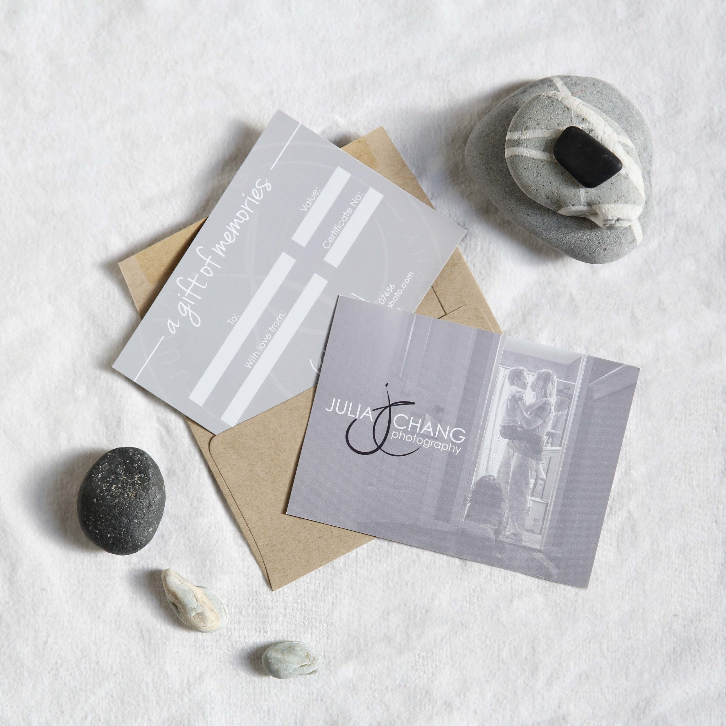 gift certificates in envelope with rocks