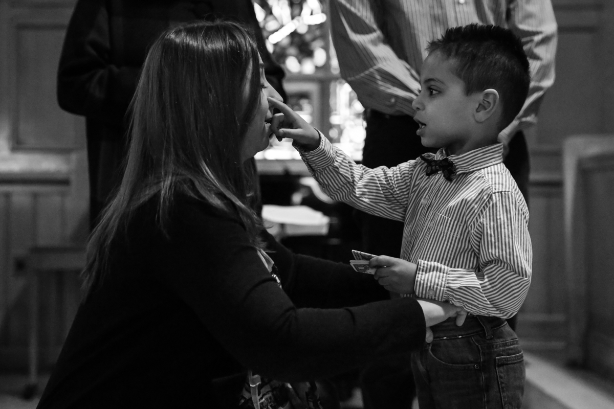 Boy touches mothers cheek with finger