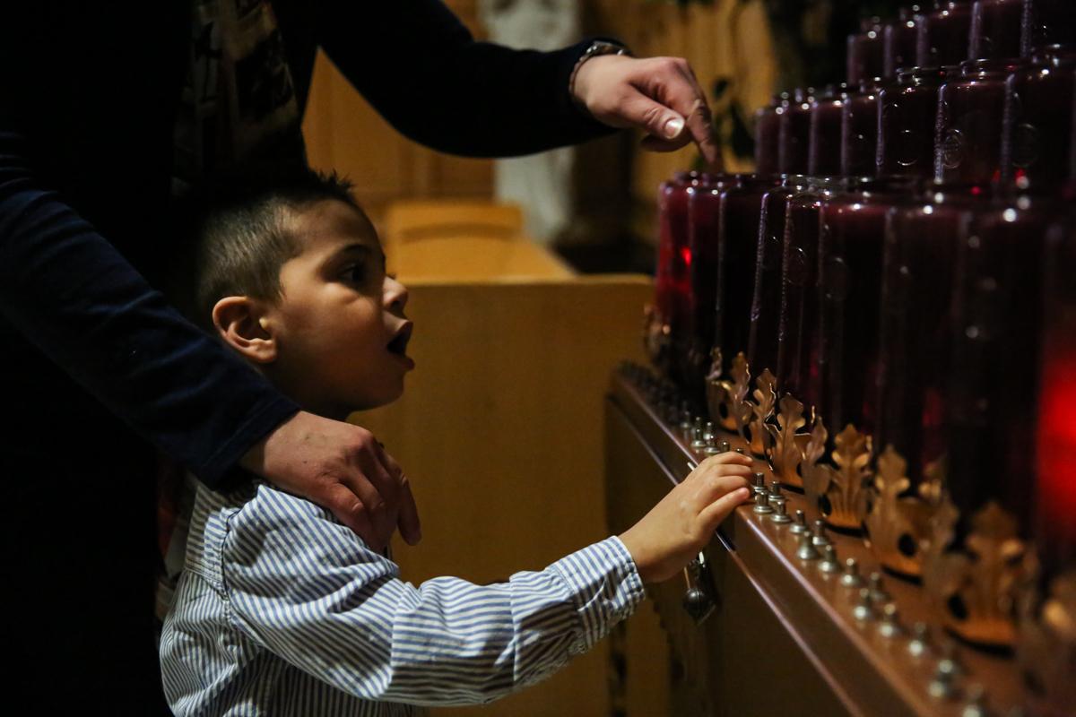 Boy lights church candle
