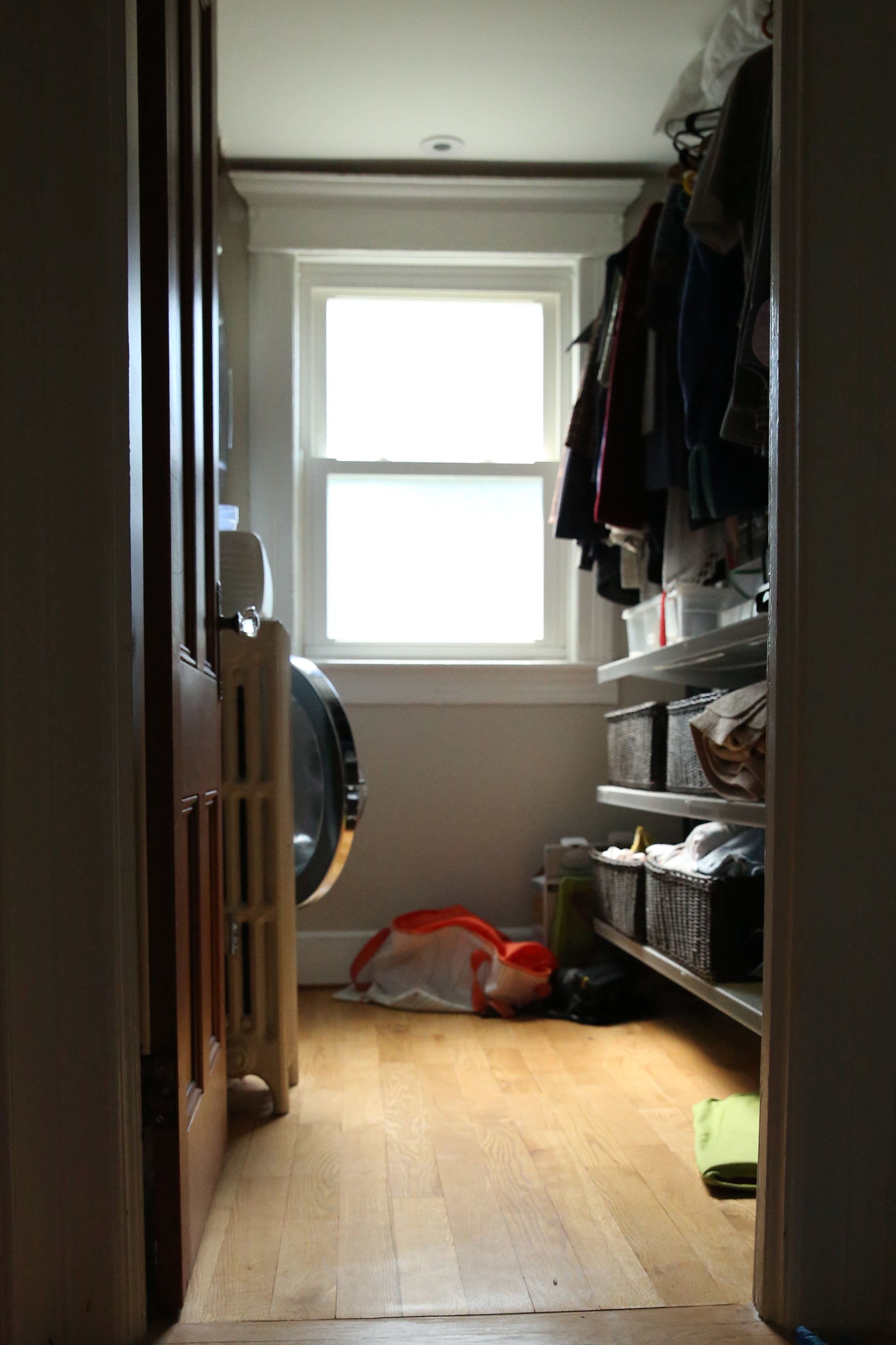 Our little laundry room closet. Just image a frantic Asian women kneeling on the floor with mounds of bedding and bath towels.