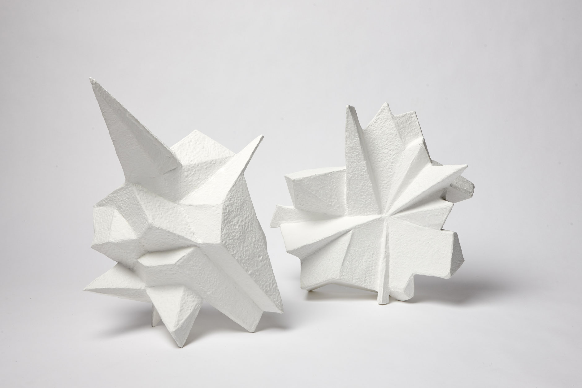 Geometric sculptures - made from multiple layers of hand-made paper, inspired by frozen, wind-swept water.height: 60cm width: 40cm depth: 20cm (approximately)