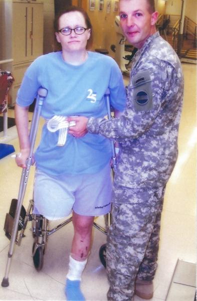 Tara_on_Crutches_With_Curt.jpg