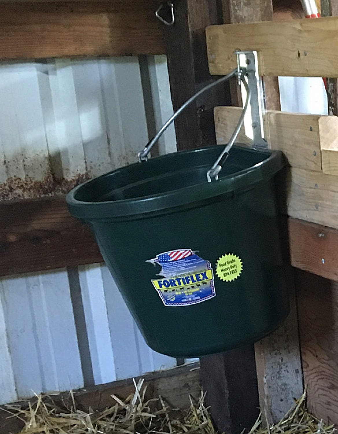 The wall mounted bucket for water.