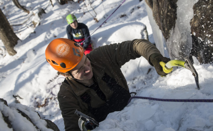 Aislinn Sarnacki |  BDN   Noah Rousseau, 14, of Appleton finds purchase with an ice ax while learning to ice climb with Equinox Guiding Service on Dec. 20, in Camden Hills State Park.