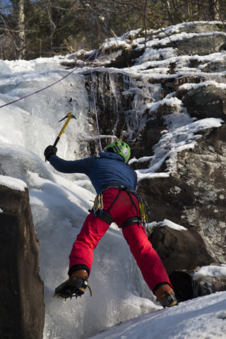 Aislinn Sarnacki |  BDN   Jack Main, 15, of Camden works his way up a wall of ice in Camden Hills State Park on Dec. 20.