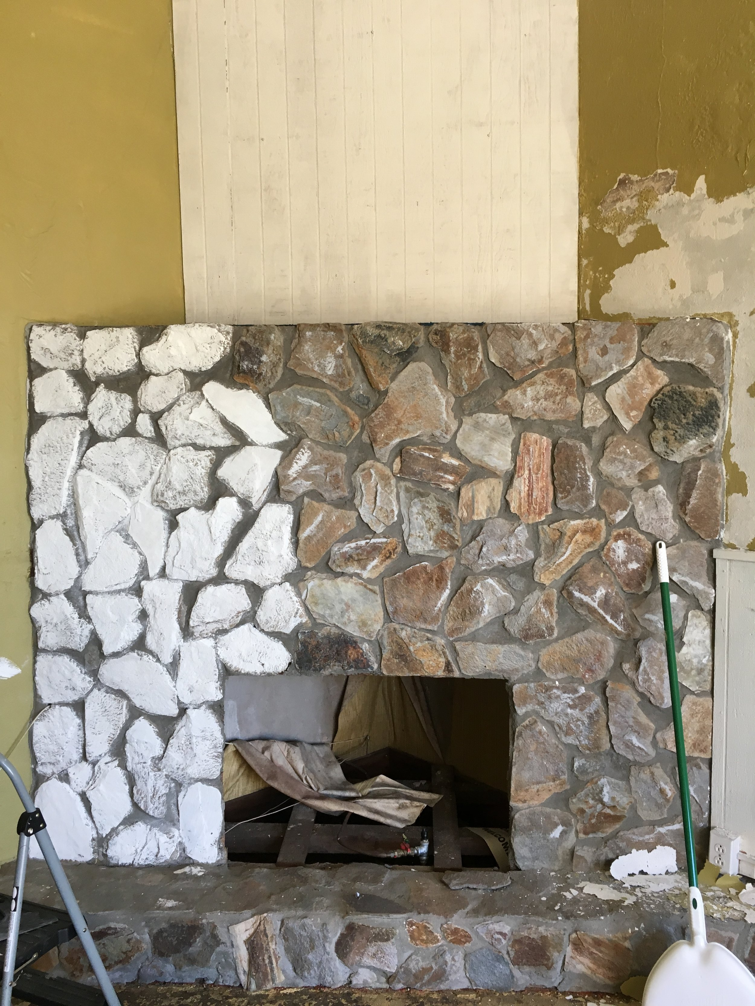 So the transformation begins....Chalk painted rock fireplace.