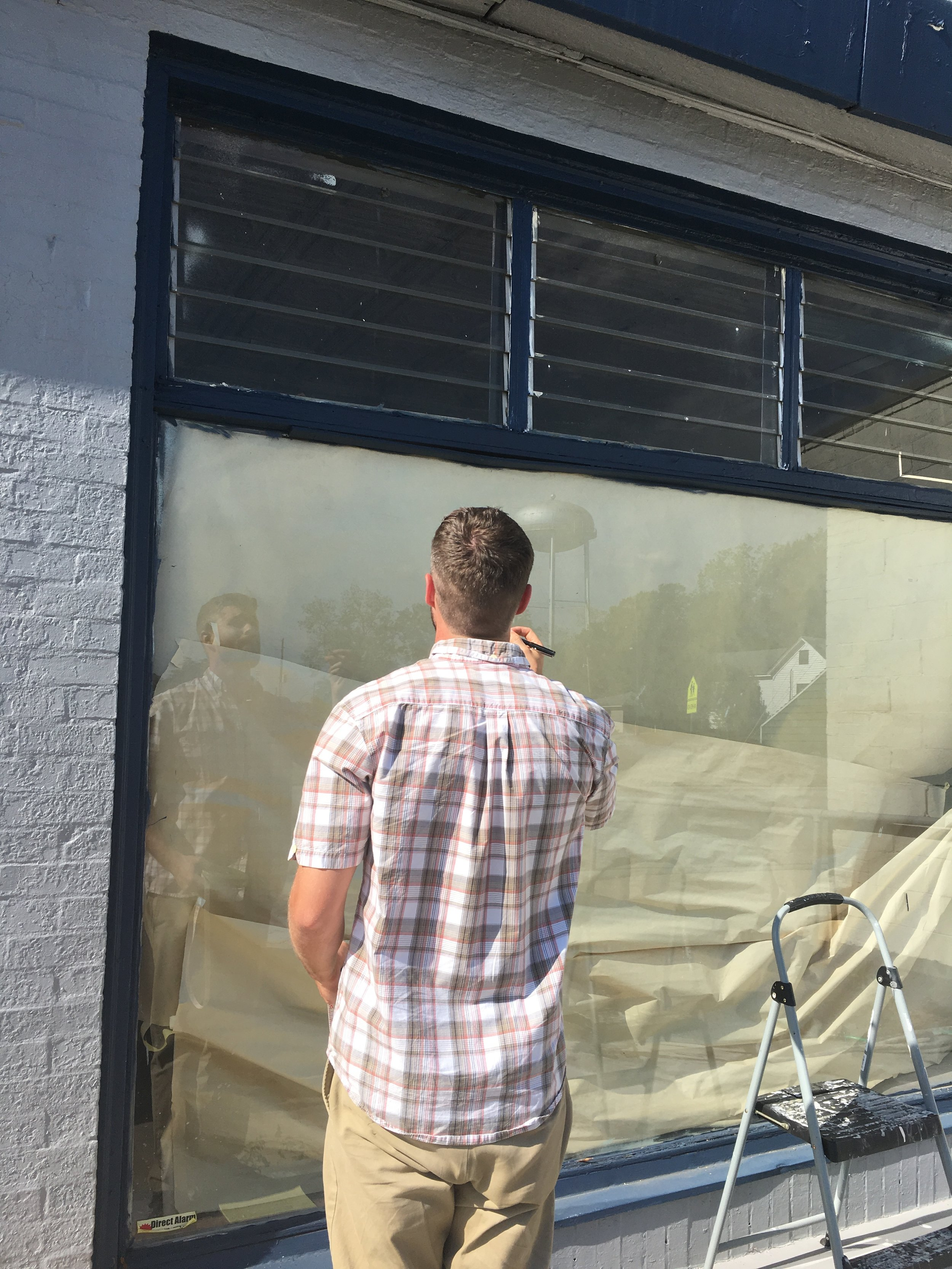 My contractor James Anderson Checks our work and takes some more measurements getting ready for our new storefront.  -