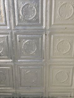 We have begun spraying the pressed tin ceiling a glorious silver to reflect the light.