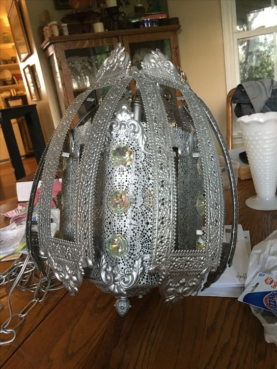 One of my two beautiful gypsy lamps which will hang near the front picture window. They have received a coat of looking glass paint and each crystal was removed, cleaned, rewired and replaced. I can't wait to see these beauties in action!