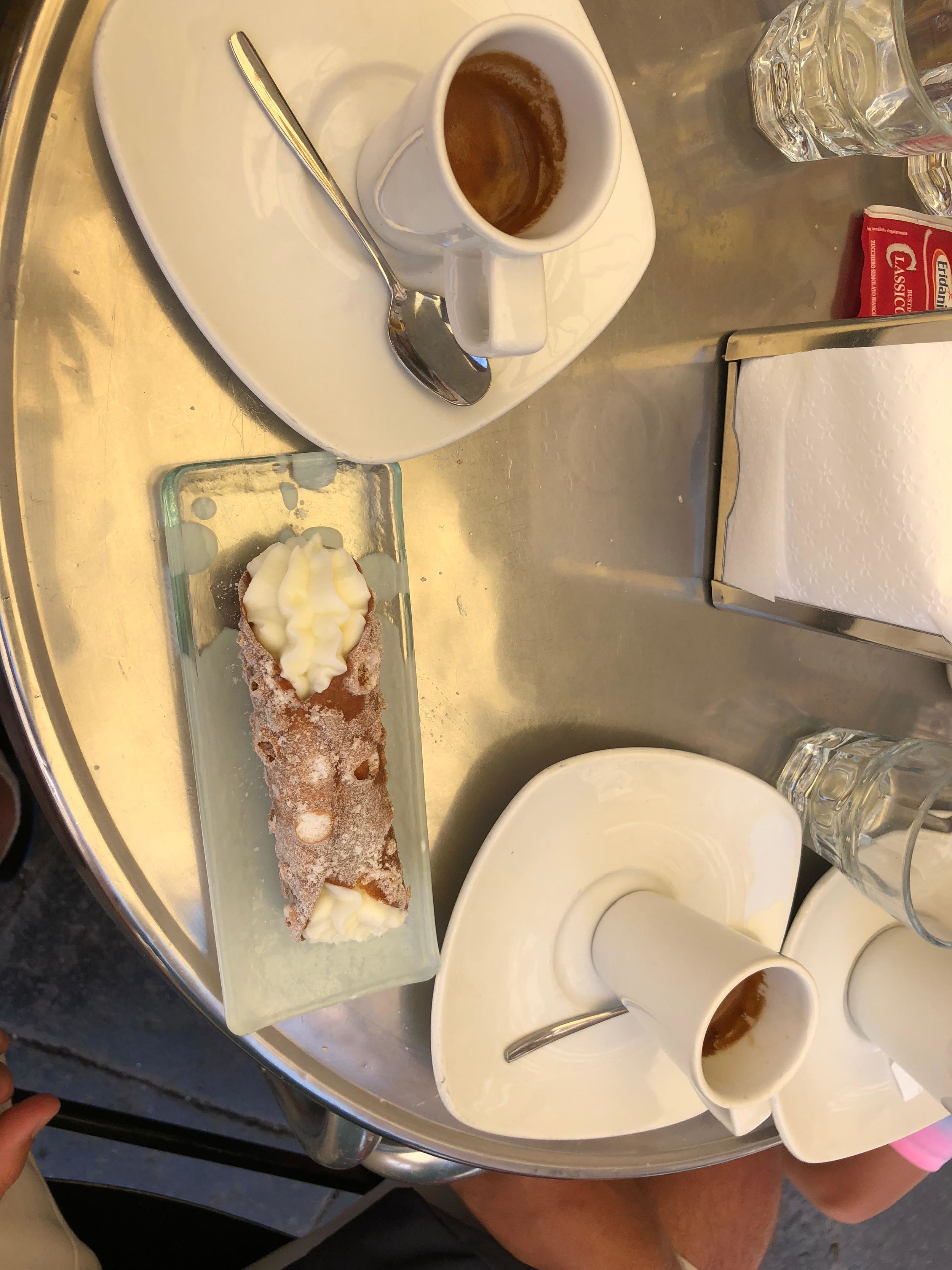The world's most perfect cannolo, paired perfectly with bitter espresso at Caffe Sicilia.