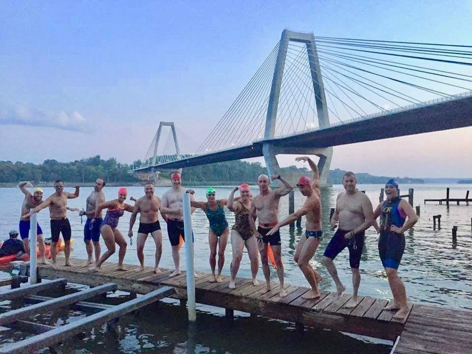 "Labor Day 2017 ""Bridge to Bridge"" participants (left to right) Andrew Magazine, John Fischbach, Brad Parks, Jennifer Brey, Thomas Altstadt, Creighton Benoit, Nina Norris, Terri Torres, Shep Sanford, Mike Jotautas, Michael Johmann, Merri Ann Schmitt pose for a photo before the start of the swim."