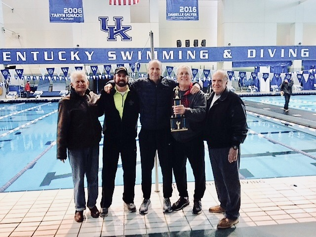 Western Kentucky Green Gators display the division trophy received at the Wildcat Invitational Masters Swim Meet at the University of Kentucky on 3-3-19.