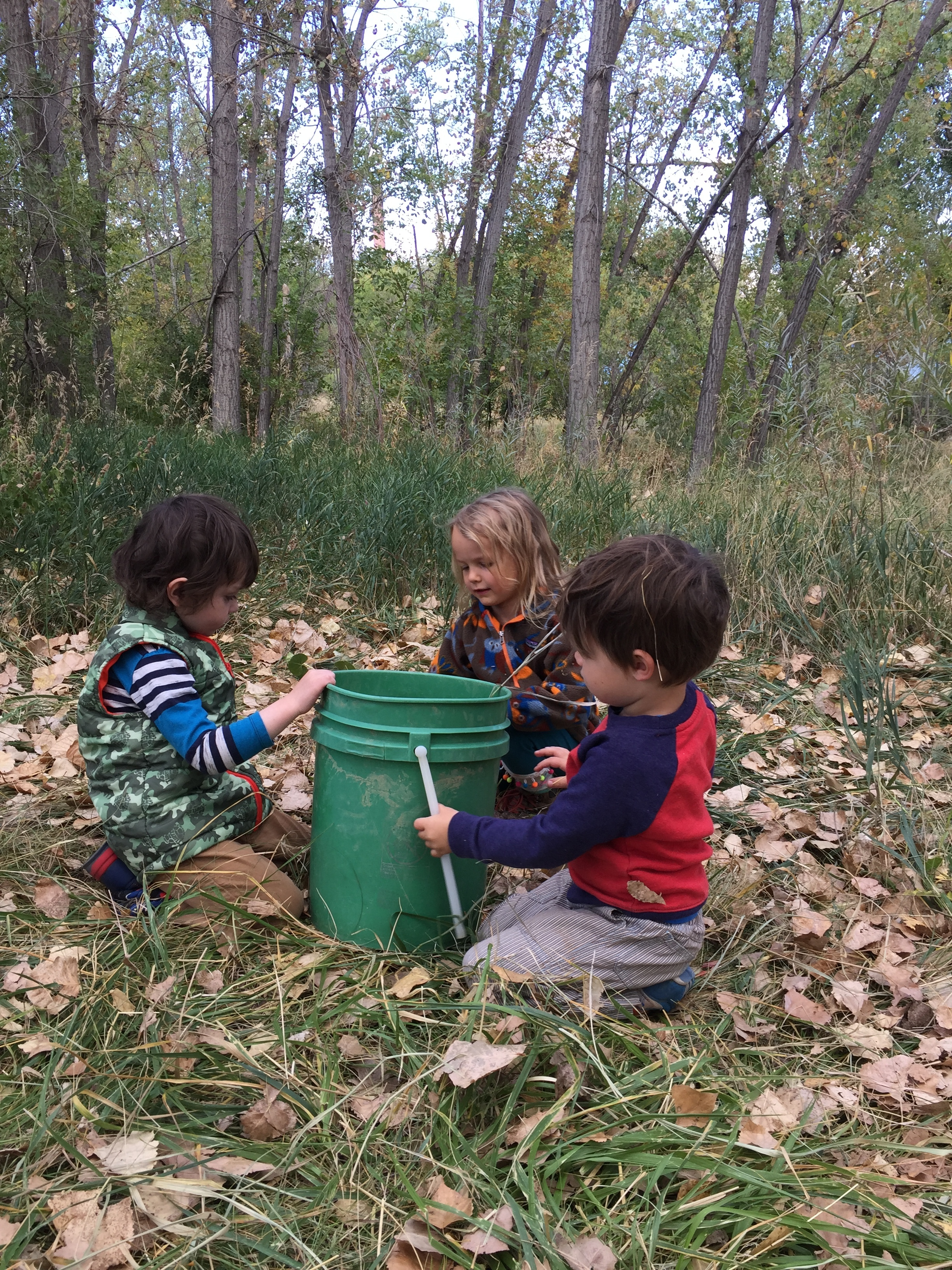 The kids helped each other fill the bucket and then took turns dumping in on their heads.