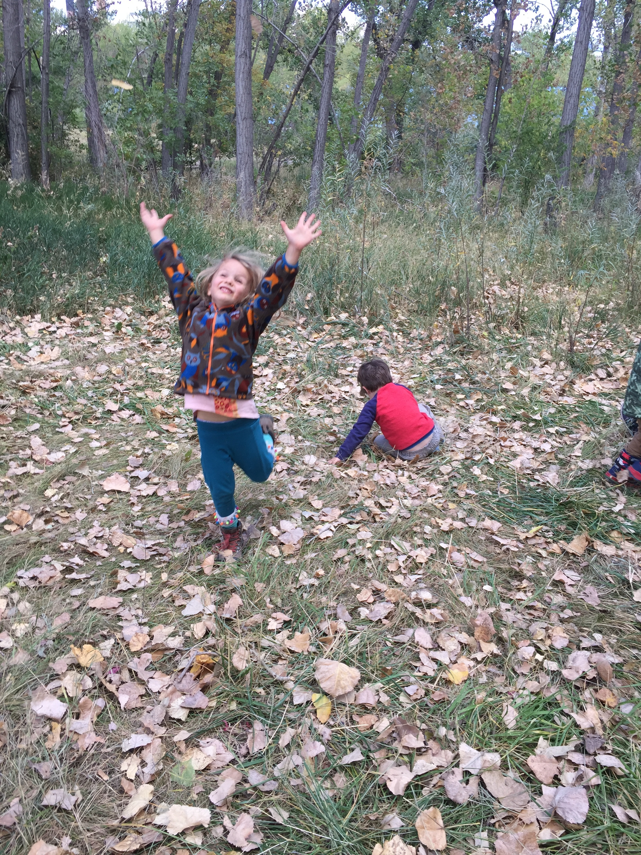 Joyful play is so important! The kids got a healthy dose of joy thanks to our friendly trees dropping their leaves on us.