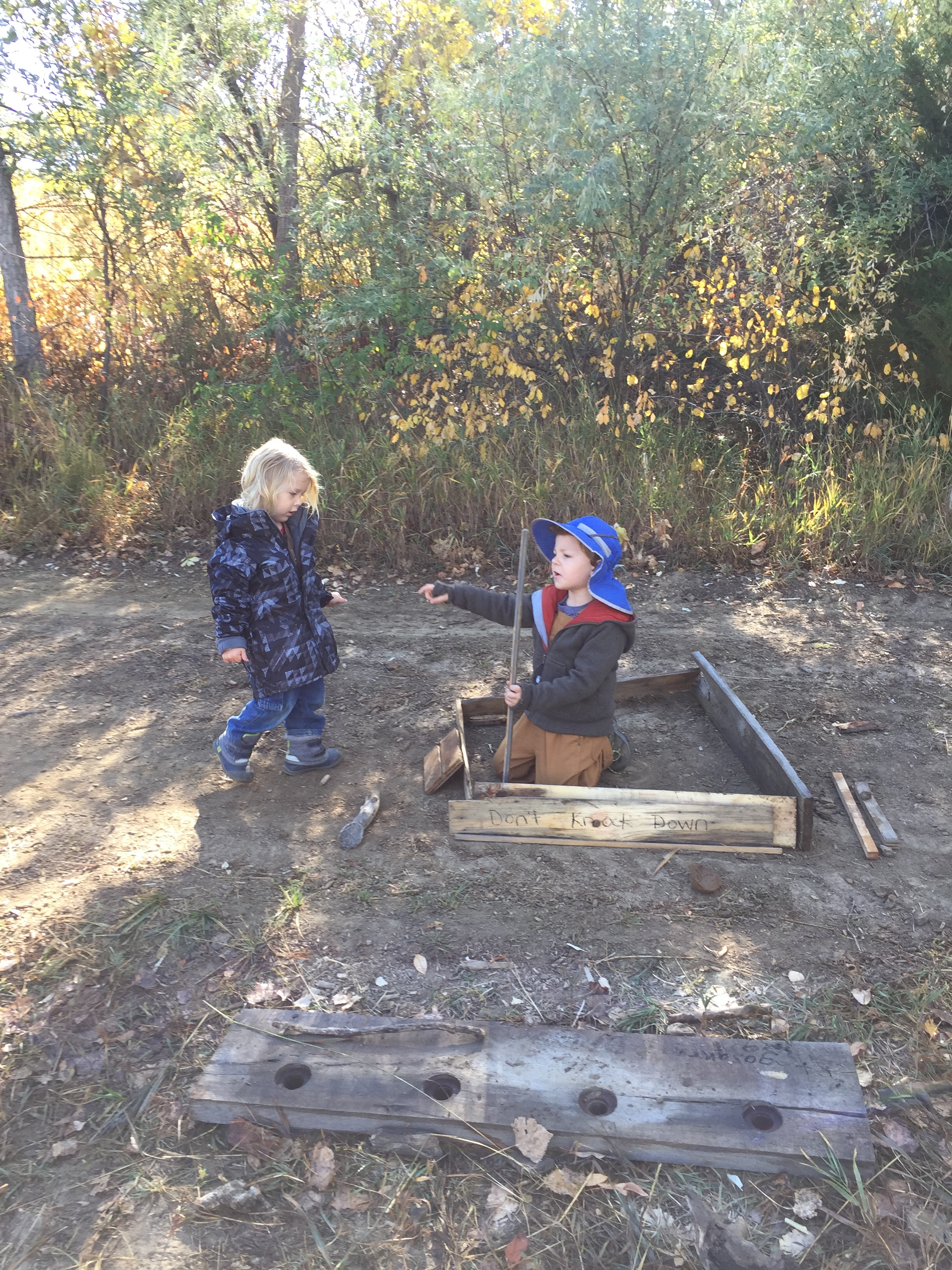 Working together—later these two plus another friend tilled their soil with sticks. The shorter sticks were easier to use, they reported.