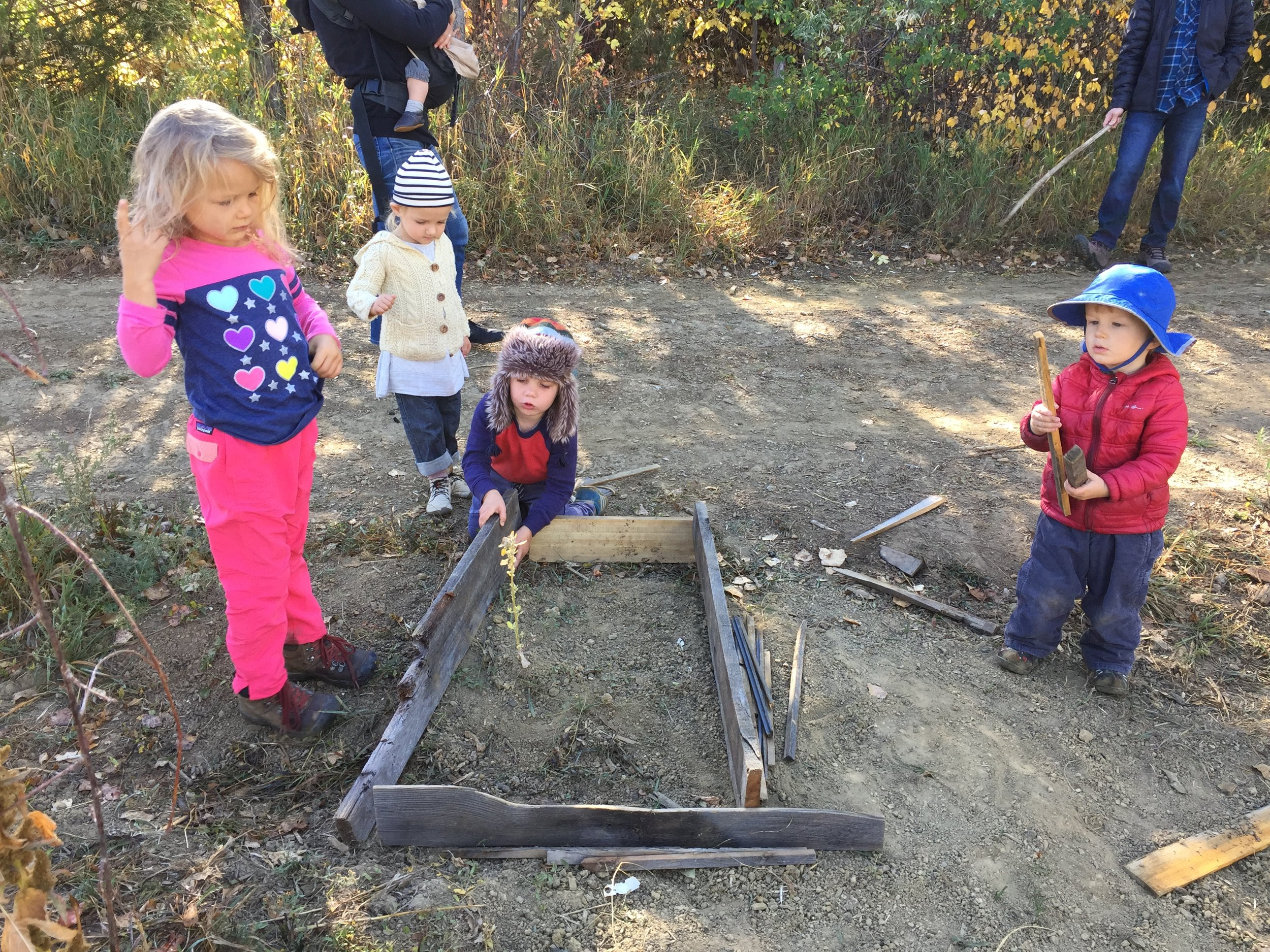 Learning to care for one another is a big part of our mission—and we often see it in action. One child helped another plant a flower in a beautifully constructed garden bed!