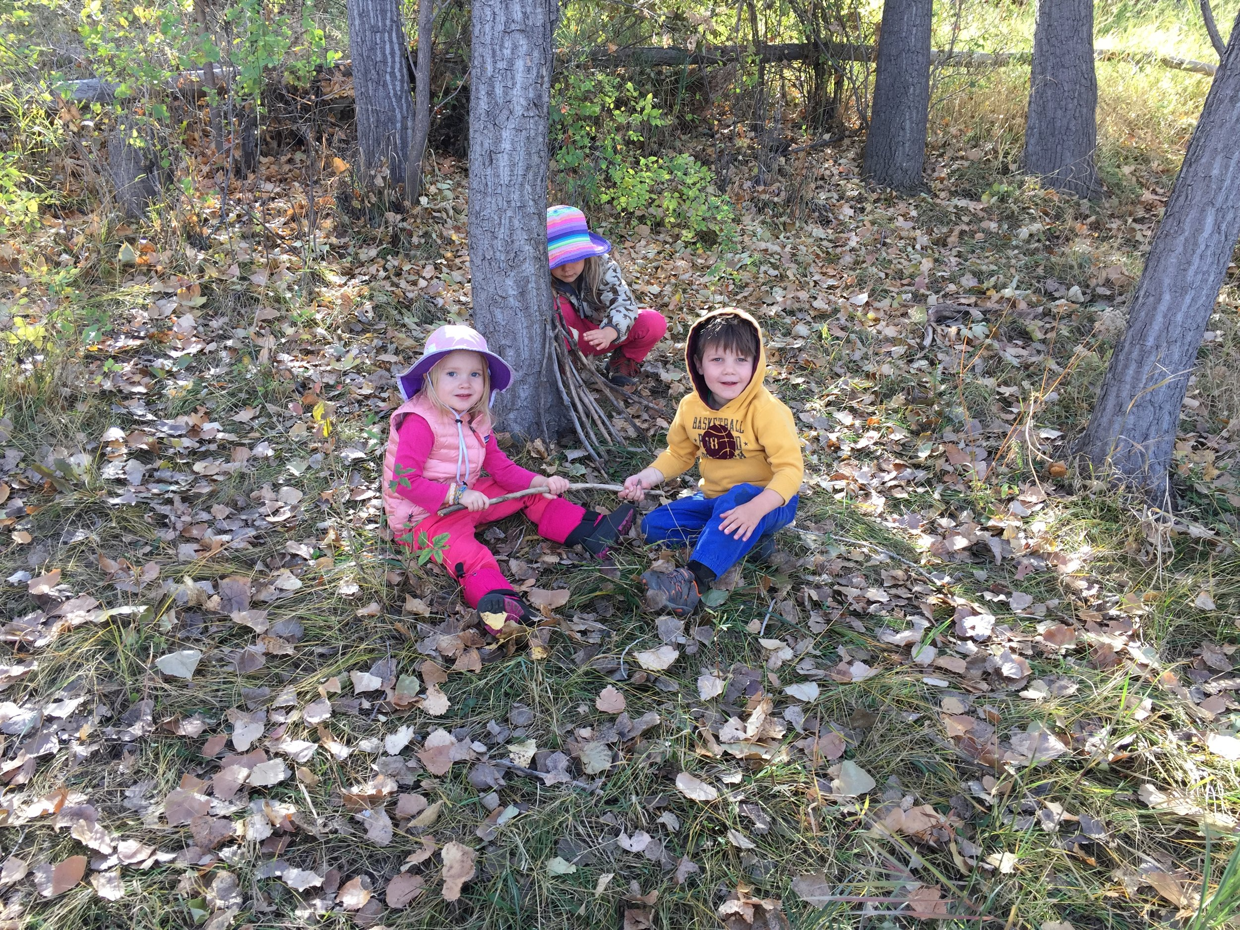 While some children were working on a fairy den, one child wanted to join in by taking the sticks apart, and luckily good-natured laughter ensued—what a funny trick! The children are learning all kinds of social communication, which will serve these little forest folk well throughout their lives.