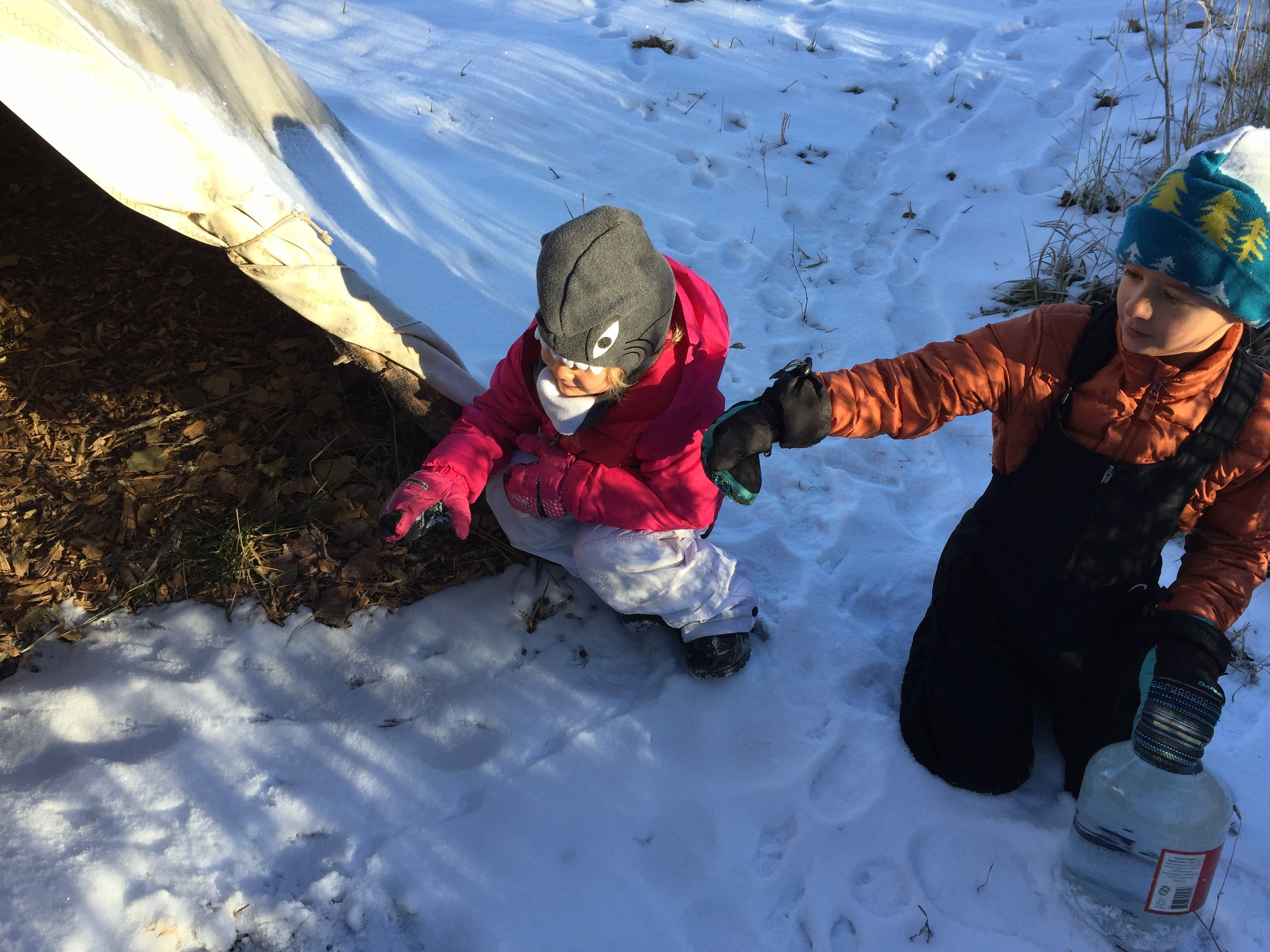Pointing out the magpie tracks leading into the tipi.
