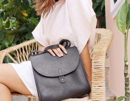 Juliette Convertible Leather Bag - Handmade in Haiti.Full-grain Haitian vegetable tanned leather. Solid brass hardware. Interior leather pocket. Worn as a backpack or cross-body tote.