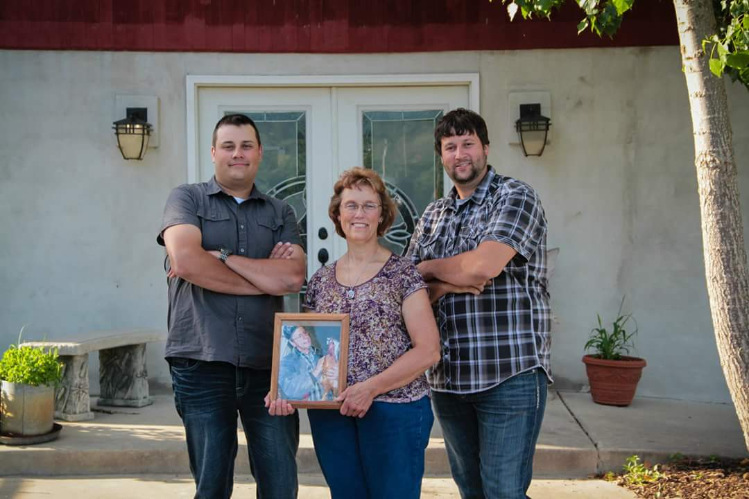 Lynn and her two boys, who are huge part of the farm.