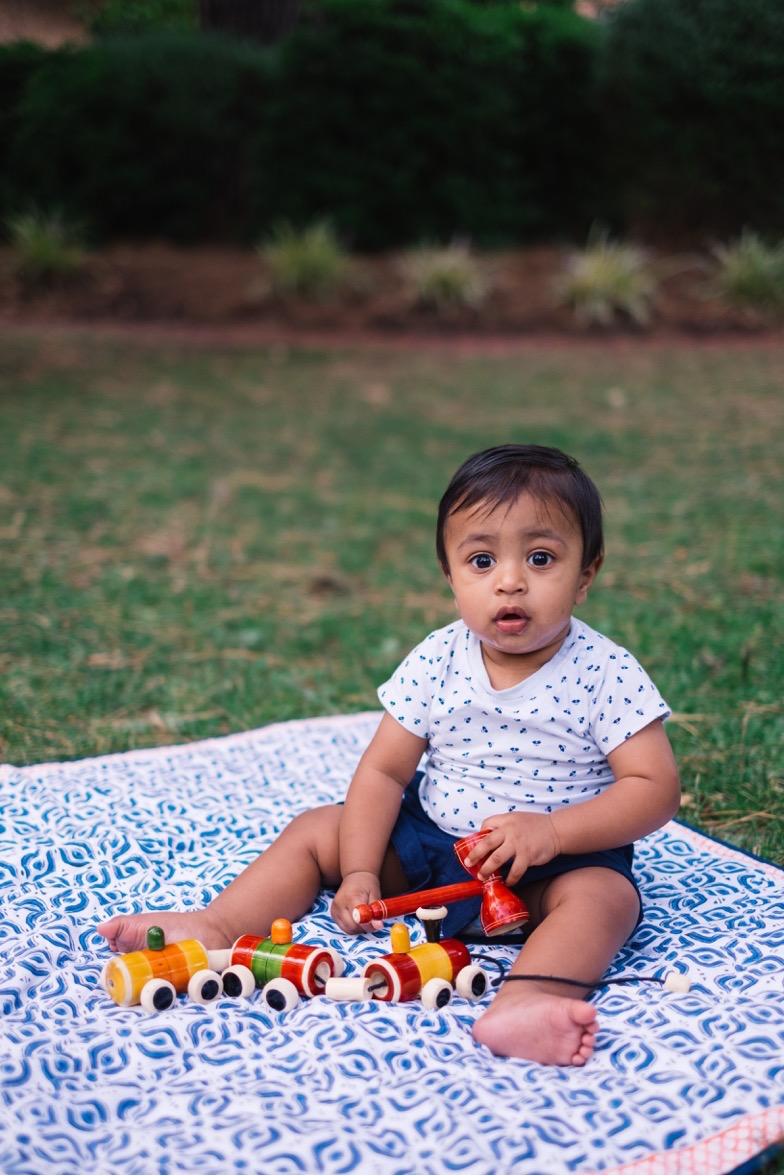 Gaayathri's son on Baby Pepper's four leaves quilt. Image by Dave Hawkswood