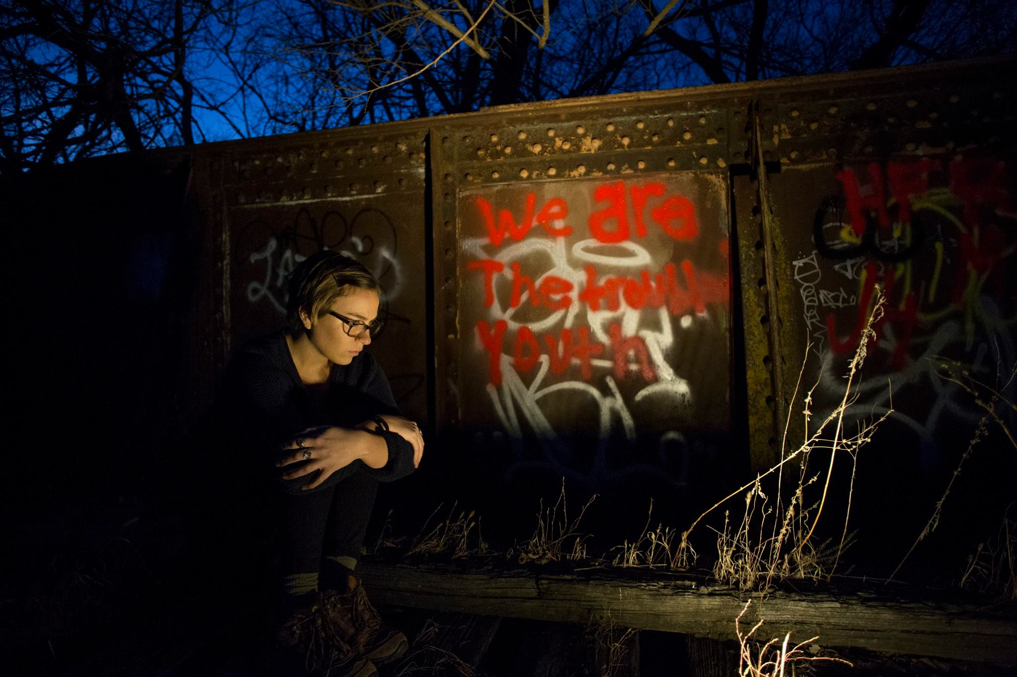 "Self-portrait at the site of the Rock Island Train Wreck, where 11 people died in 1894. The graffiti illuminated here reads, ""We are the troubled youth."""