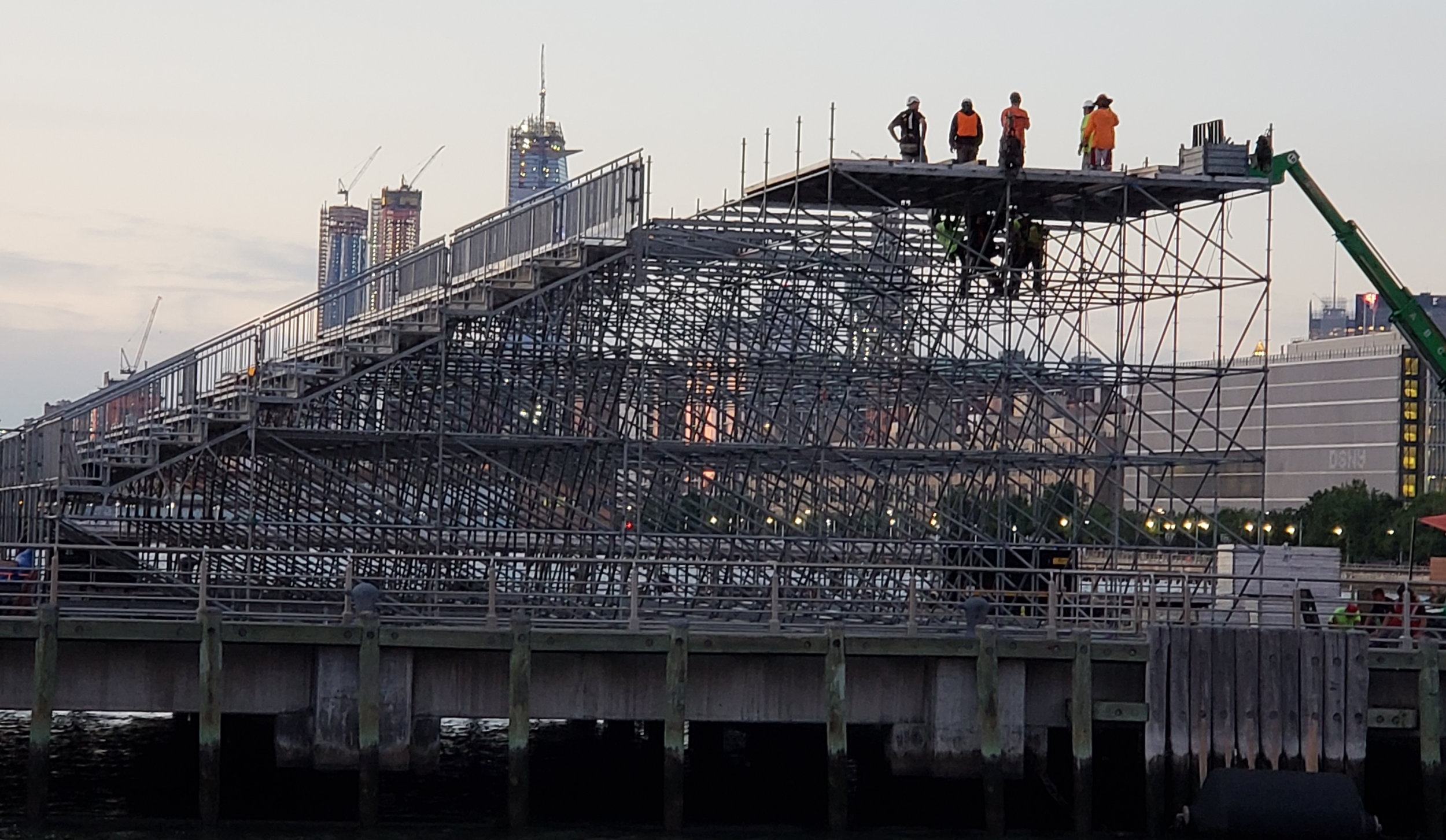 © James T. Snyder  Photograph: construction workers high on a scaffold without safety equipment on.