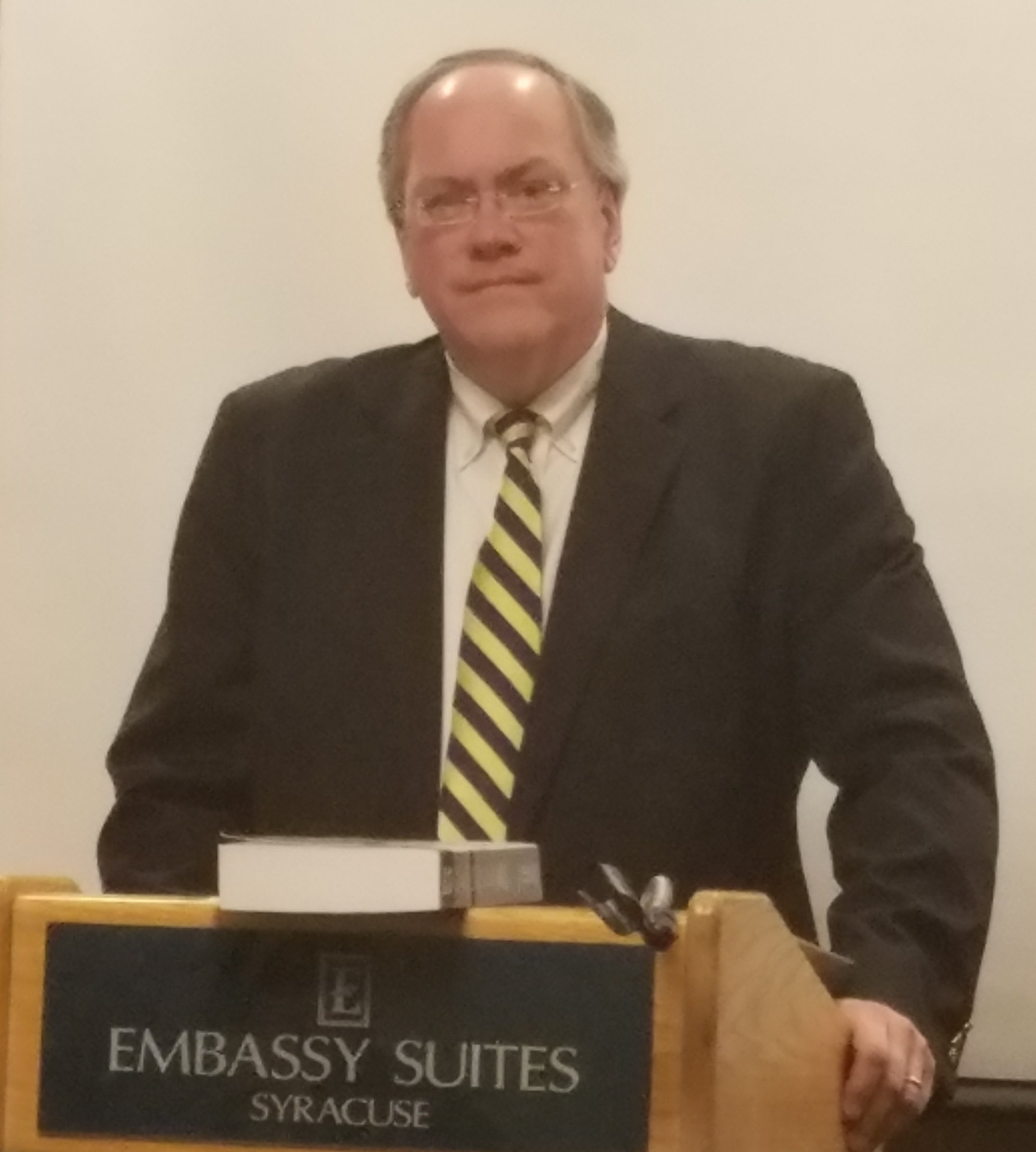 Photo of James T. Snyder, Esq., at lecture podium, instructing at a CLE.