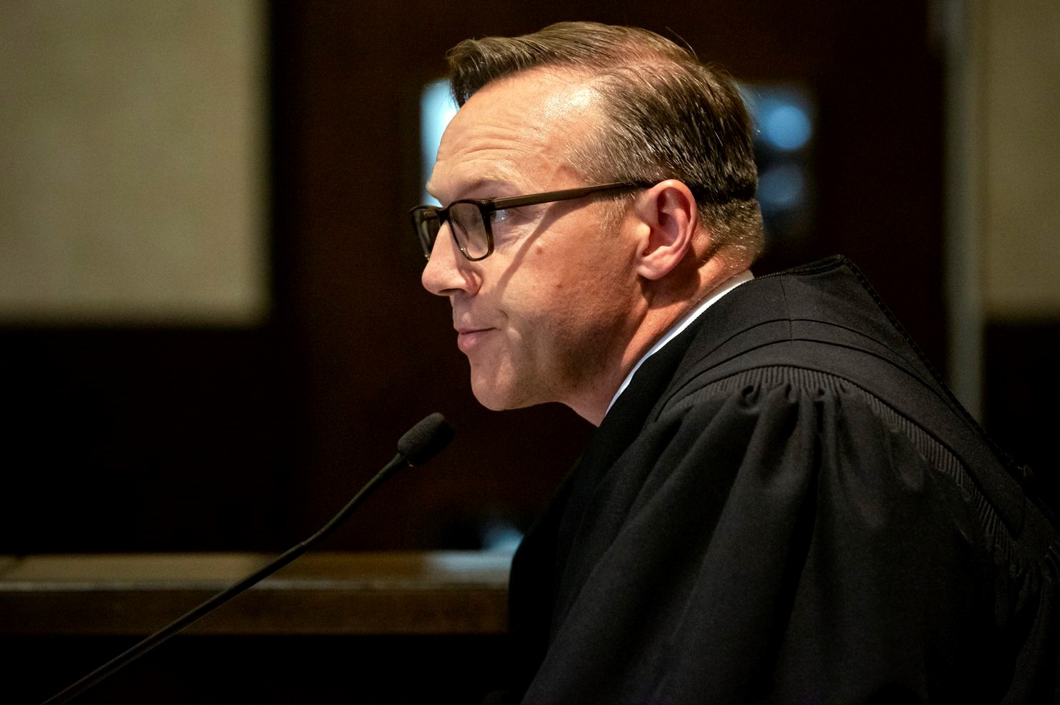 Cleveland County, Okla., District Judge Thad Balkman reads his Aug. 26 decision ordering Johnson & Johnson to pay the state of Oklahoma $572 million to help abate the opioid crisis. (Chris Landsberger/AP), from  https://www.washingtonpost.com/opinions/2019/09/09/lawsuits-against-companies-arent-just-about-getting-money-theyre-about-revealing-truth/