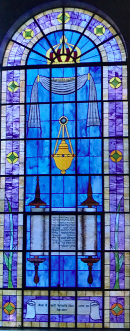 STAINED GLASS WINDOWS   The Synagogue's fifteen original large stained glass windows were reconstructed. The original scriptural references are pictured on the stained glass.