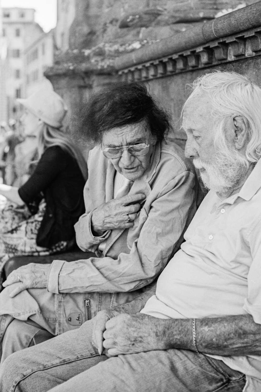 A conversation in the Piazza della Signoria, Florence, Italy, 2017.
