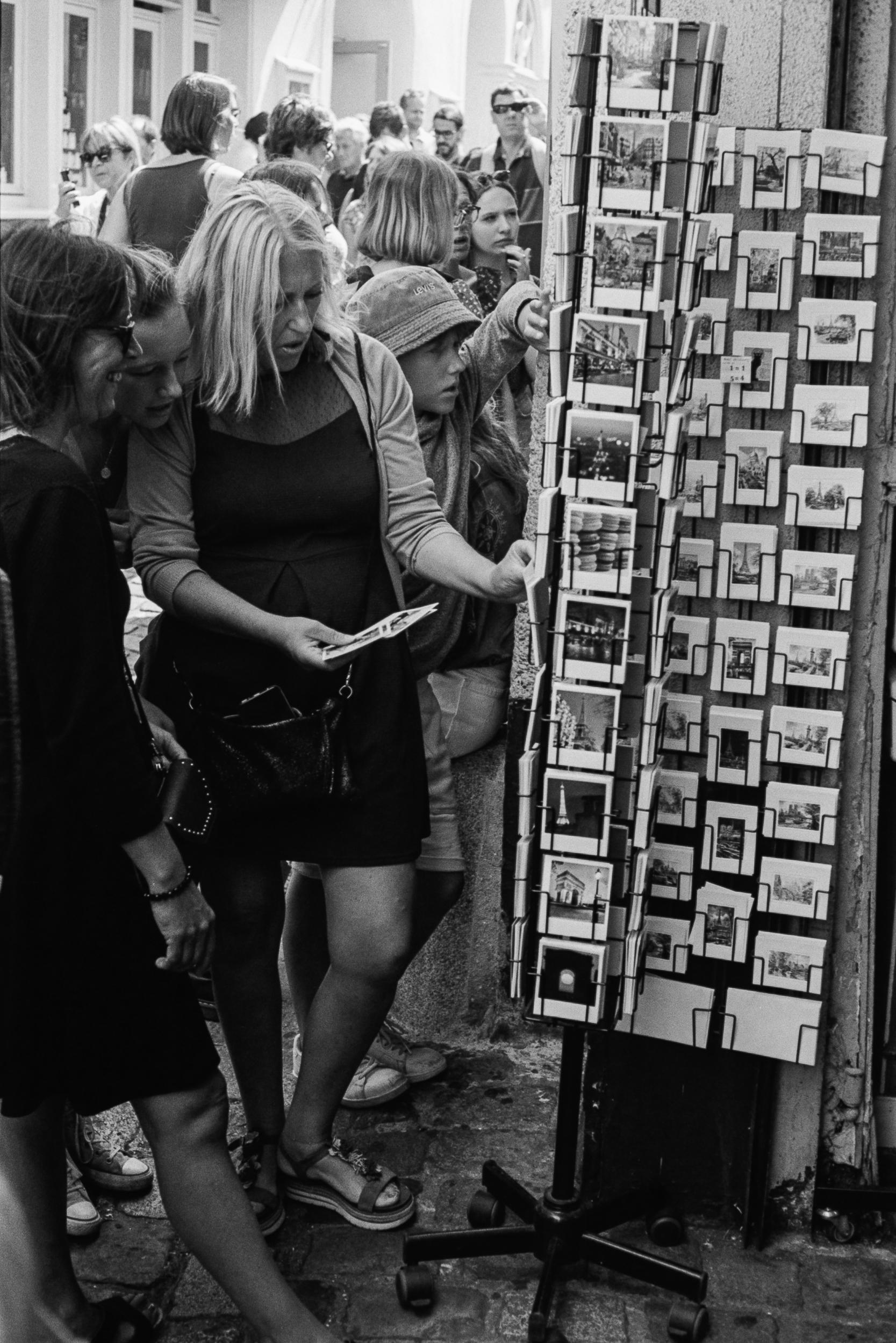 Shopping for postcards, Montmartre, Paris, 2019.