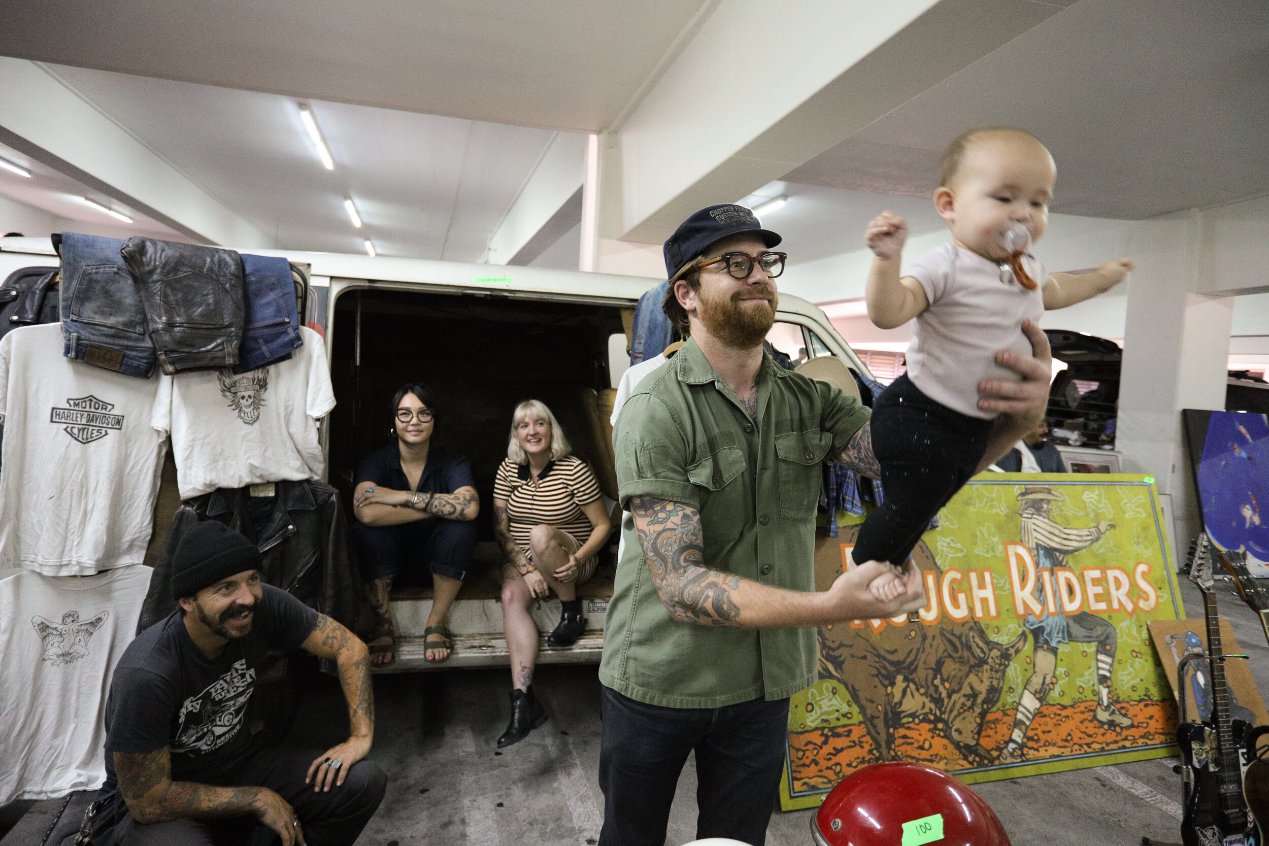 Nicholas Slobin/ Courier Shawn McKinney holds his baby while his friends look on in enjoyment at the Pasadena City College Flea Market on Sunday, September 1, 2019.