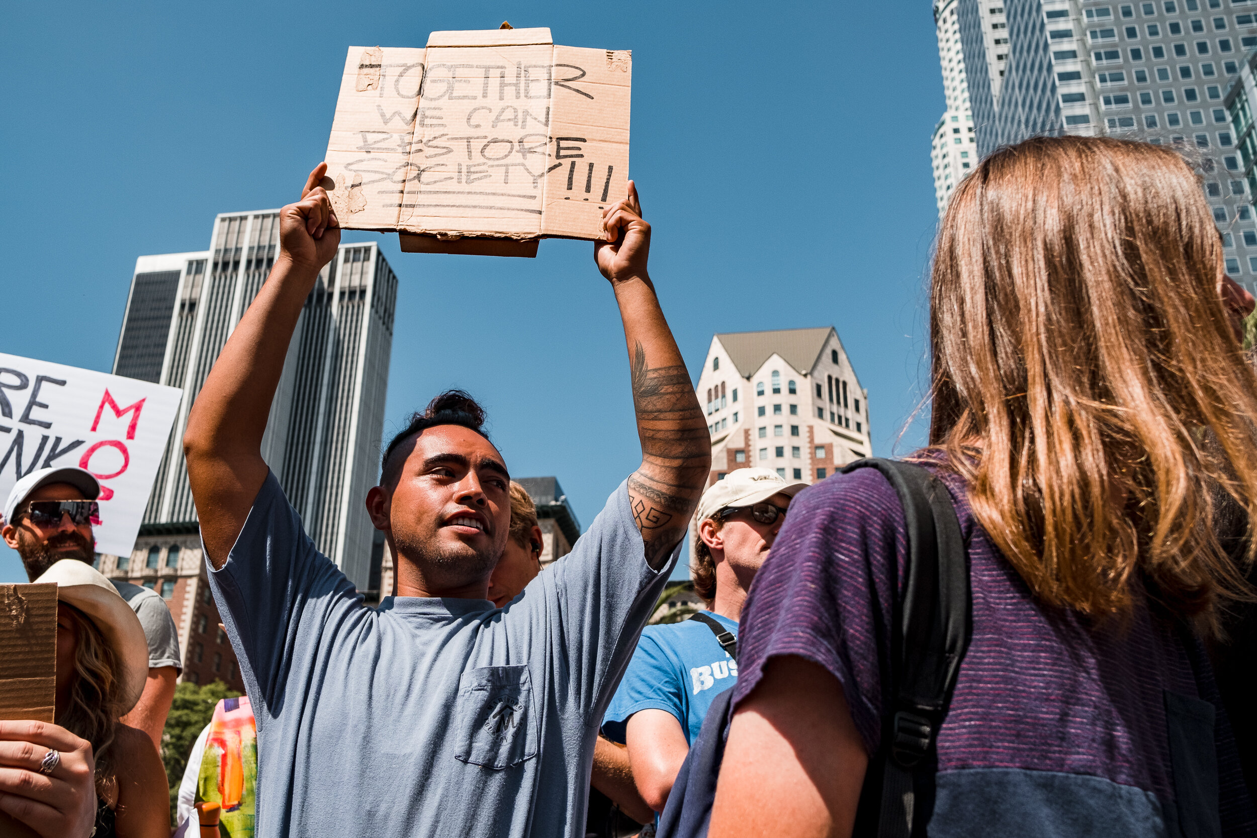 Nicholas Slobin/ Courier Devyn Reyes of Inglewood, Calif. holds a sign at the Global Climate Strike in Downtown Los Angeles on Friday, September 20, 2019.