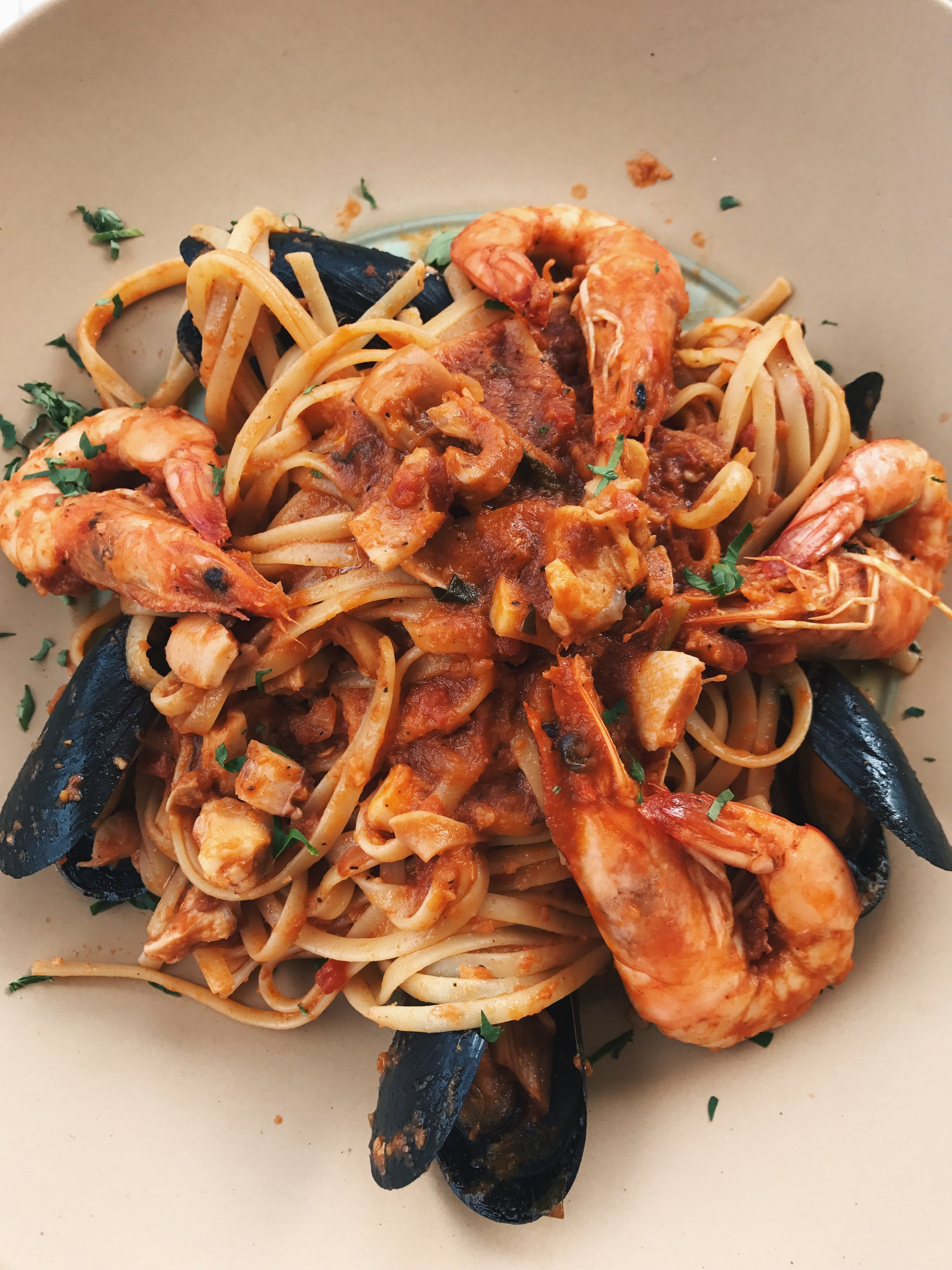 seafood linguine with shrimps, mussels, and squid