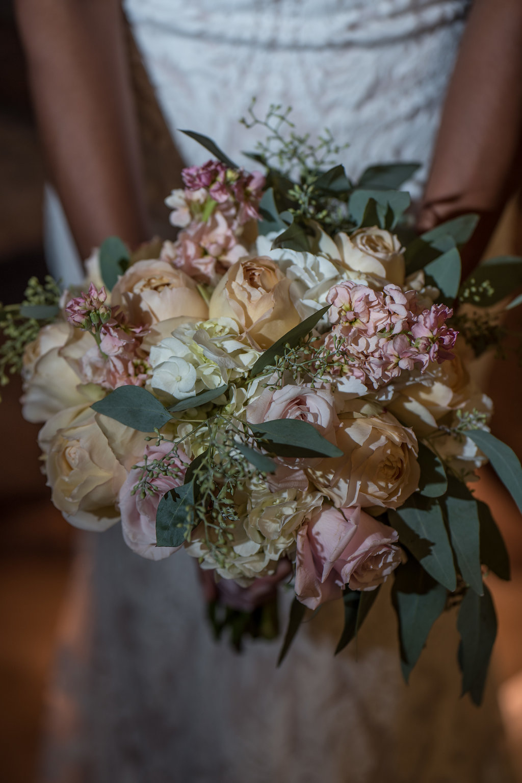 Bride with beautiful wedding bouquet,part of a Boho Brewery Wedding Styled Shoot at Triple C Barrel Room in Charlotte NC. Bouquet by Clux Florals.