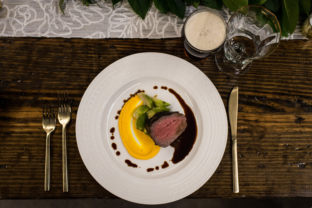 Detail shot of food, Roast Beef with sweet potato puree and jus,part of a Boho Brewery Wedding Styled Shoot at Triple C Barrel Room in Charlotte NC. Table,setting, and food provided by Best Impressions Caterers and Party Reflections.