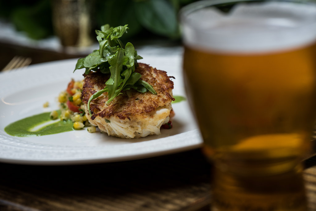 Detail shot of food, crab cake with southern succotash,part of a Boho Brewery Wedding Styled Shoot at Triple C Barrel Room in Charlotte NC. Table,setting, and food provided by Best Impressions Caterers and Party Reflections.