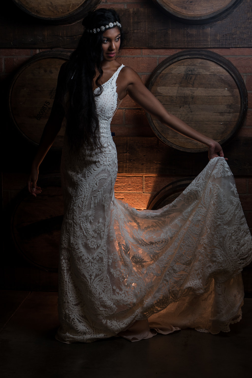 Dramatic Bridal Portrait,part of a Boho Brewery Wedding Styled Shoot at Triple C Barrel Room in Charlotte NC. Dress and Accessories by Paige and Elliot.