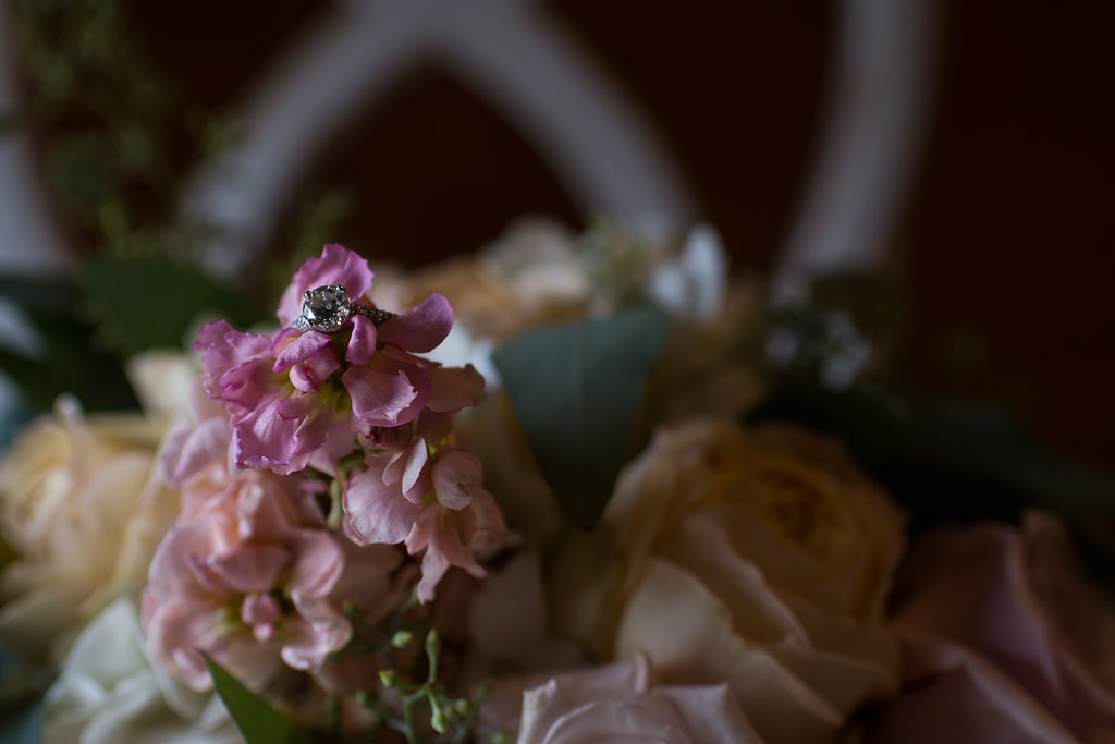 Detail shot of a wedding ring in a beautiful wedding flower bouquet,part of a Boho Brewery Wedding Styled Shoot at Triple C Barrel Room in Charlotte NC. Bouquet by CLux Florals.