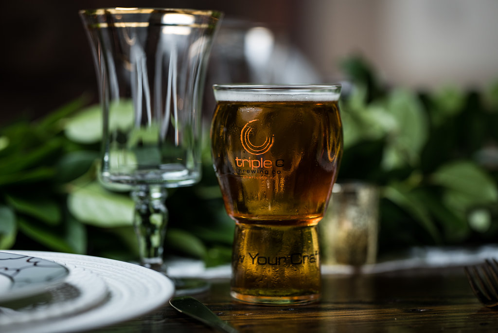 Detail shot of beer,part of a Boho Brewery Wedding Styled Shoot at Triple C Barrel Room in Charlotte NC. Table and setting provided by Best Impressions Caterers and Party Reflections, beer provided by Triple C Brewery.