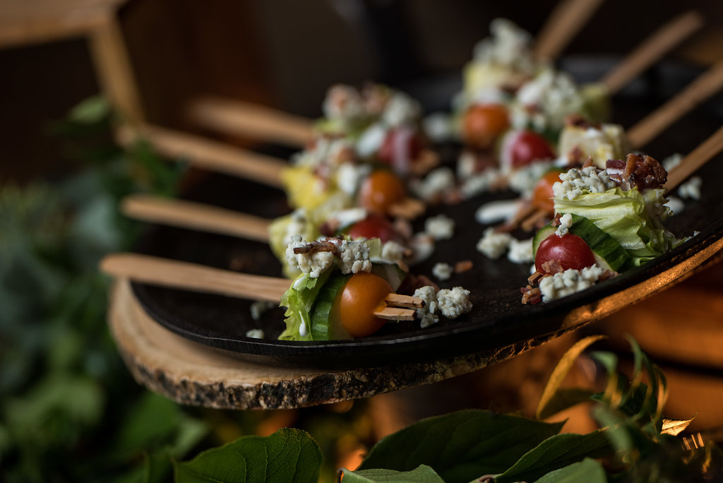 Detail shot of food, caesar salad skewers,part of a Boho Brewery Wedding Styled Shoot at Triple C Barrel Room in Charlotte NC. Table,setting, and food provided by Best Impressions Caterers and Party Reflections.